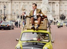 Mr Bean, played by Rowan Atkinson, celebrates the character's 25th anniversary by driving down The Mall in front of Buckingham Palace, London, on his trademark Mini. PRESS ASSOCIATION Photo. Picture date: Friday September 4, 2015. To coincide with the anniversary the Ultimate Collection DVD boxset is available from Monday 7 September and new animated Mr Bean episodes arrive on Boomerang on Saturday 5 September. Photo credit should read: John Stillwell/PA Wire